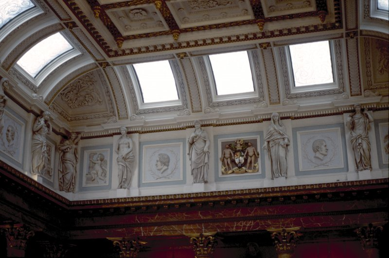 View of the frieze in the Hall, showing portrait profiles of Mathew Bailie, John Abercrombie and John Thomson, with representations of Hygeia, the coat of arms of the Royal College of Physicians and two panels carved with a cherub.