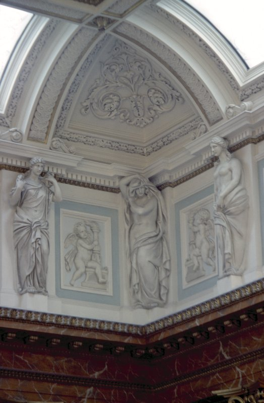 View of the frieze in the Hall, showing representations of Hygeia and two panels carved with a cherub.