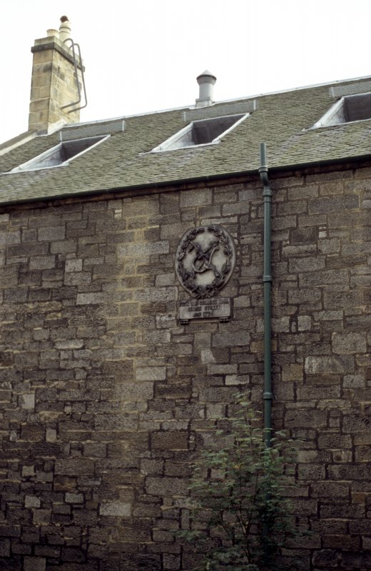 View of the Royal College of Physicians roundel, set into top of exterior wall of New Library (Sir Robert Sibbald Physic Garden).