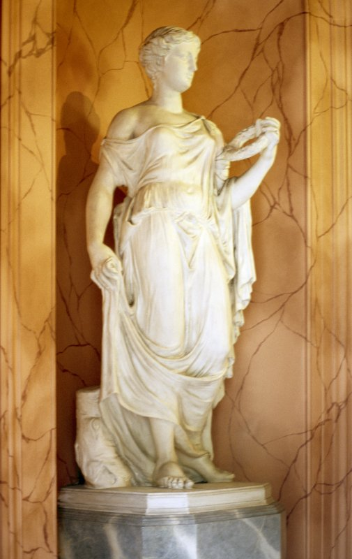 View of statue of female figure (Panacea?), on E side of vestibule of main entrance.