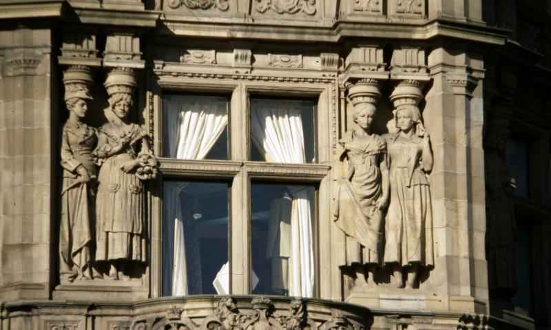 View of two pairs of caryatids representing England (left) and Scotland (right), first floor, corner bay.
