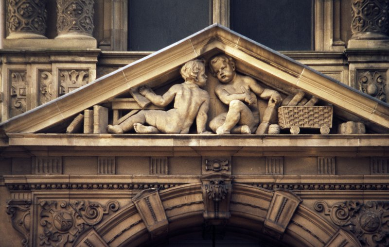 View of pair of putti, in triangular pediment above entrance to Jenners on South St David Street, Edinburgh.