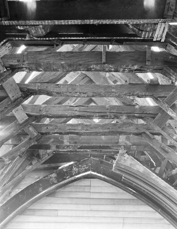 Interior. View of rafters meeting tower.