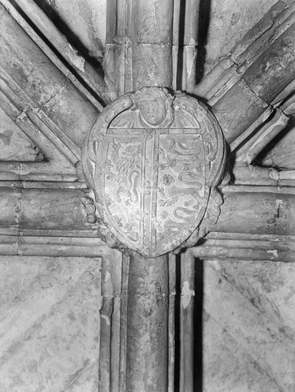 Interior. View of boss carved with coat of arms, in Chapter House.