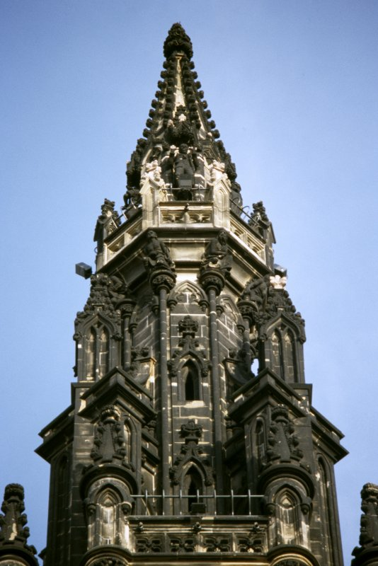 View of statue of Dominie Sampson, on the fourth gallery (top of Scott Monument), W side. Supporting the fourth gallery are druids.