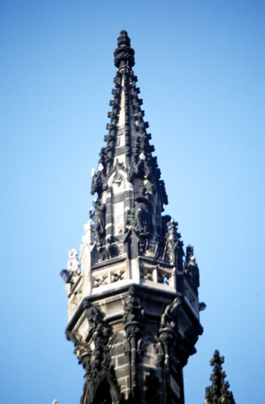 View of statue of Meg Dods, on the fourth gallery (top of Scott Monument), N side. Supporting the fourth gallery are druids.