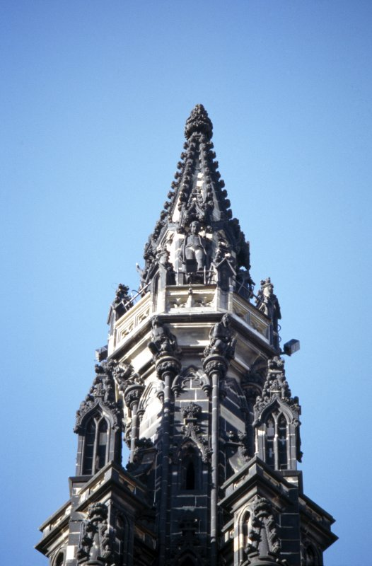 View of statue of Dandie Dinmont, on the fourth gallery (top of Scott Monument), E side. Supporting the fourth gallery are druids.