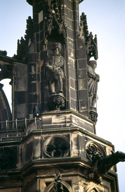 View of statue of James VI, on upper tier of SW buttress.