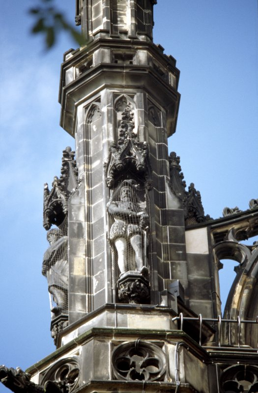 View of statue of Halbert Glendinning, on upper tier of SW buttress.