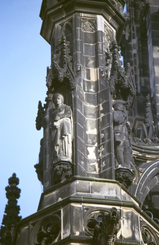 View of statues of Amy Robsart (left) and Baron Bradwardine (right), on upper tier of NW buttress.