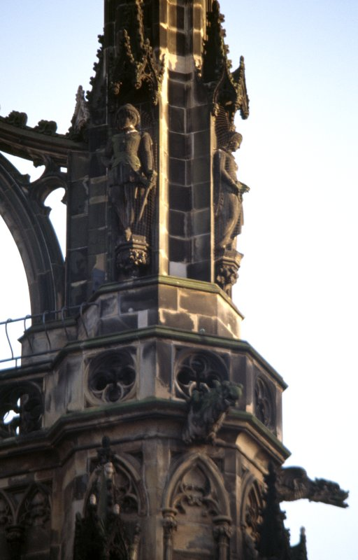 View of statues of the Earl of Leicester (left) and Amy Robsart (right), on upper tier of NW buttress.