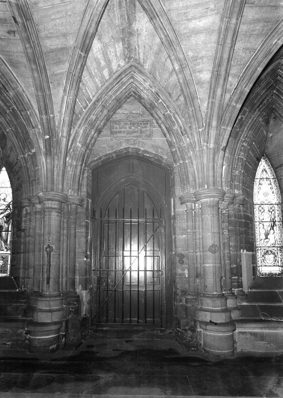 Interior. View of pillars and doorway, South chapel.