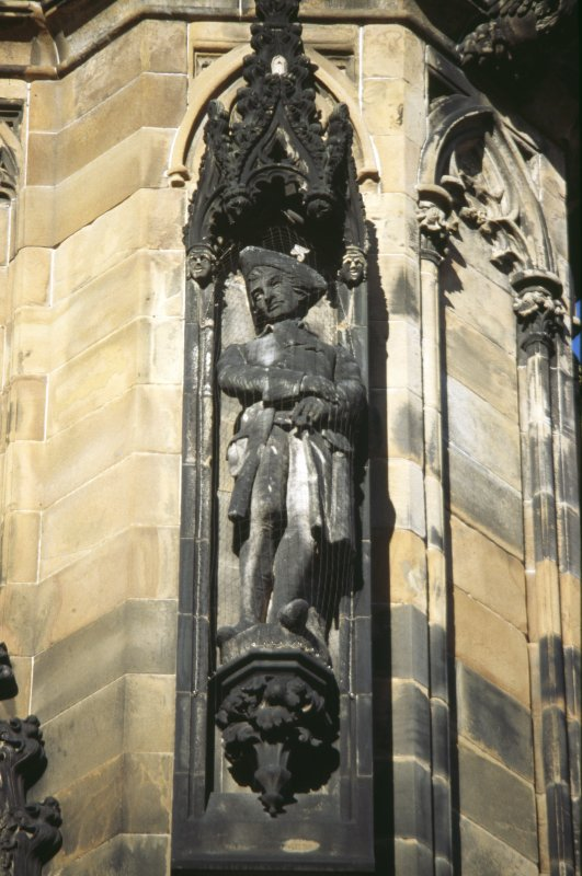 View of statue of the Laird o' Dumbiedykes, on lower tier of NE buttress.