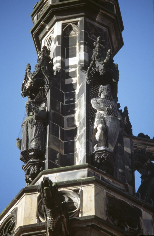View of statues of Richard Coeur de Lion (right) and Friar Tuck (left), on upper tier of SE buttress.