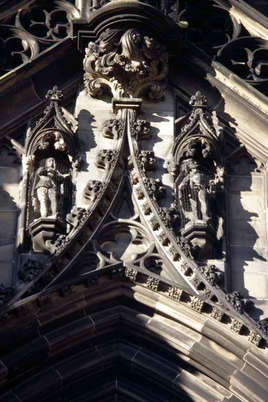 View of statues of Montrose and Richie Moniplies (left to right), above ground floor arch, E side.