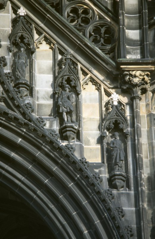 View of statues of Rose Bradwardine, the Dougal Creature and the Fair Maid of Perth (left to right), above ground floor arch, W side of Scott Monument, Princes Street, Edinburgh
