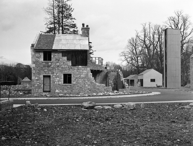 Taymouth Castle, Military Camp. View of training area - Rescue Reconnaissance, elevation to Town Street showing constructed tilt in North Gable wall. Acetylene cutting shop can be seen to the left of the rescue tower.