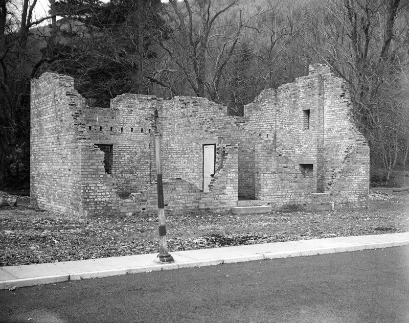 Taymouth Castle, Military Camp. View of training area showing 'Rescue under war gas conditions' with timber strutting on damaged gable. Timber strutting on damaged gable will be removed when set is dressed to allow for collapse of first floor.
