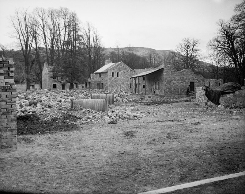 Taymouth Castle, Military Camp. View of training area looking South-West at tunnelling set with instructional veranda and two Anderson Shelters in the foreground.