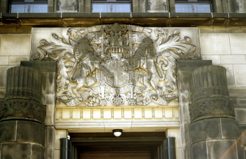 View of carved Royal Arms of Scotland, above entrance, N side.