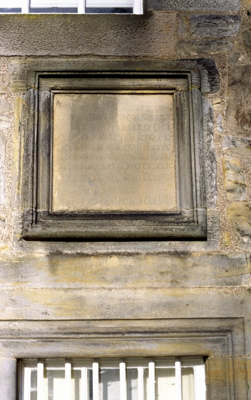 View of 'Anagramme Tablet', on wall to left of front door of Lauriston Castle.