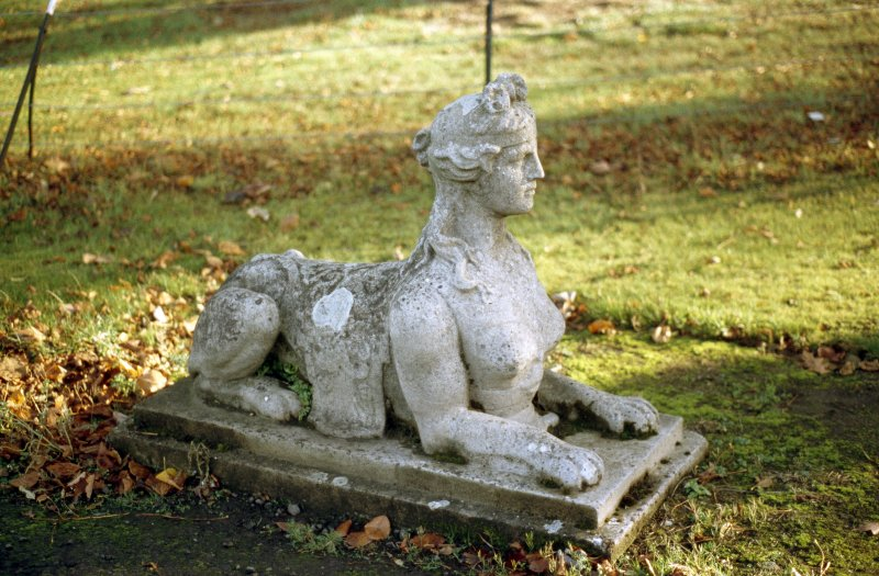 View of sphinx, one of two flanking drive beside gate house of Lauriston Castle.