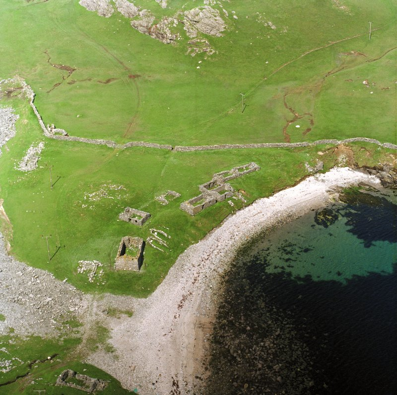 Oblique aerial view centred on the remains of the fishing station and prehistoric house, taken from the S.