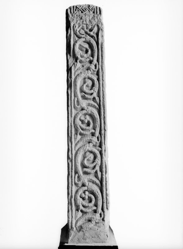 Detail showing scroll work edge on cross shaft.