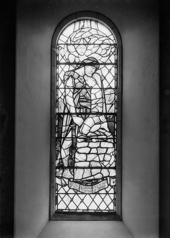 Interior. View of stained glass war memorial window.
