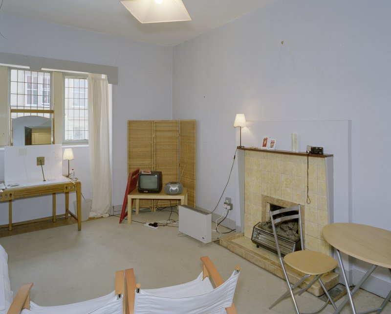 Interior.  Basement, visitor's flat, living-room, view from NW