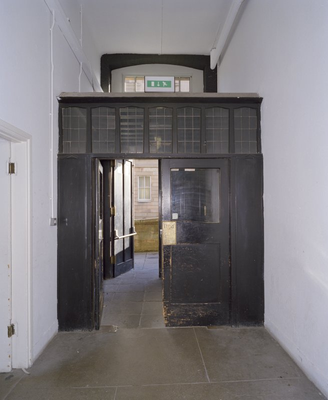 Interior.  Basement, corridor, doorway at E end, view from W