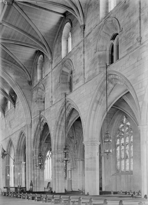 View of interior showing nave and S aisle.