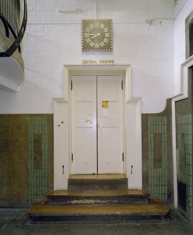 Interior.  Basement, lecture theatre door, view from E