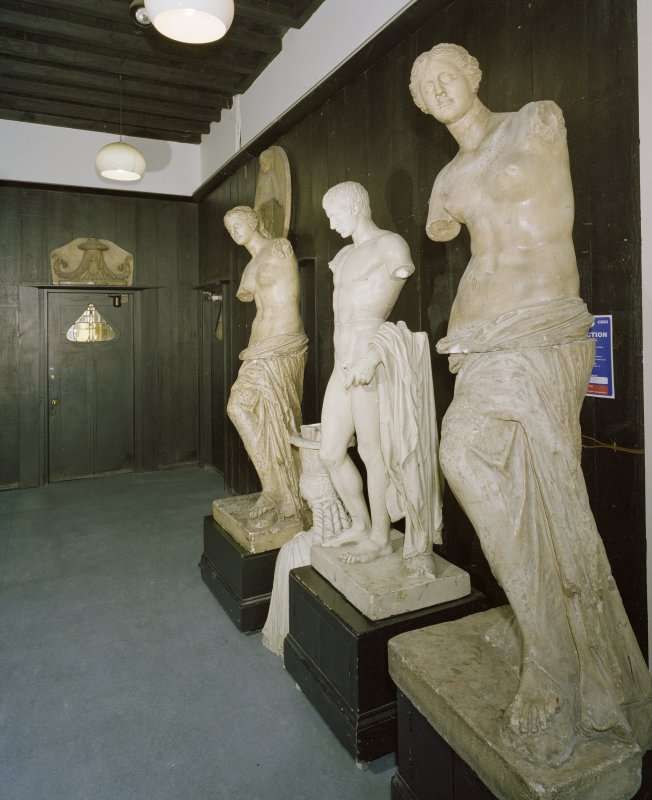 Interior.  Ground floor, E corridor, view of statues at E end