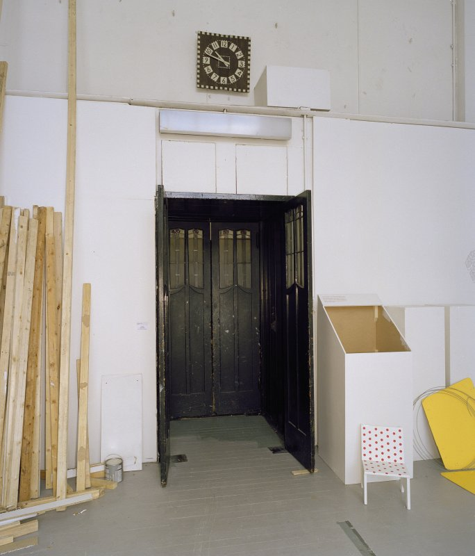 Interior.  Ground floor, E studio, view of door with clock above