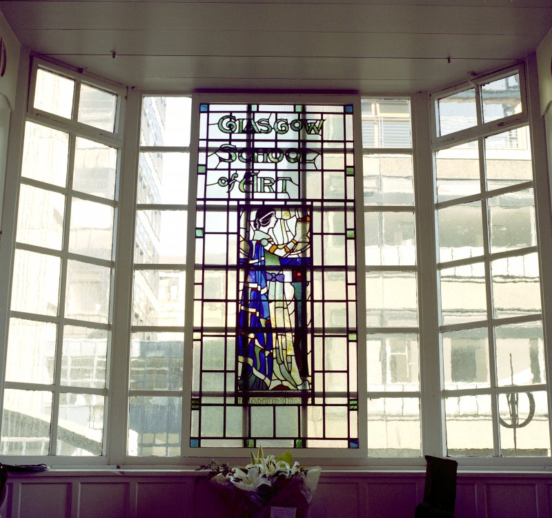Interior.  Ground floor, entrance hall, detail of stained glass window behind reception desk