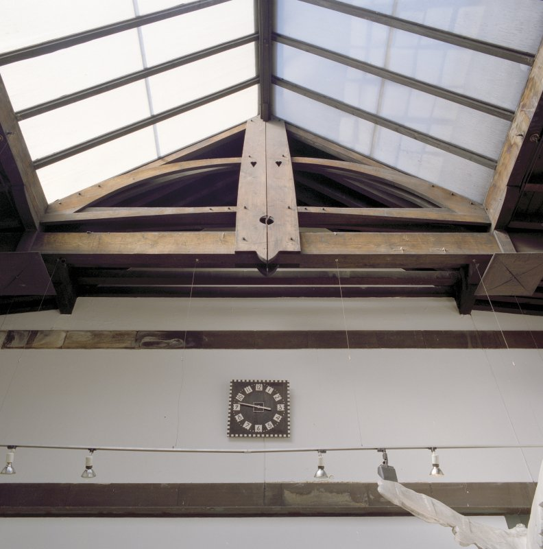 Interior.  1st floor, exhibition area, detail of roof truss and clock
