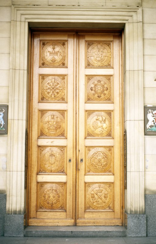 View of wooden doors carved with Scottish coins, at entrance to 42 St Andrew Square.