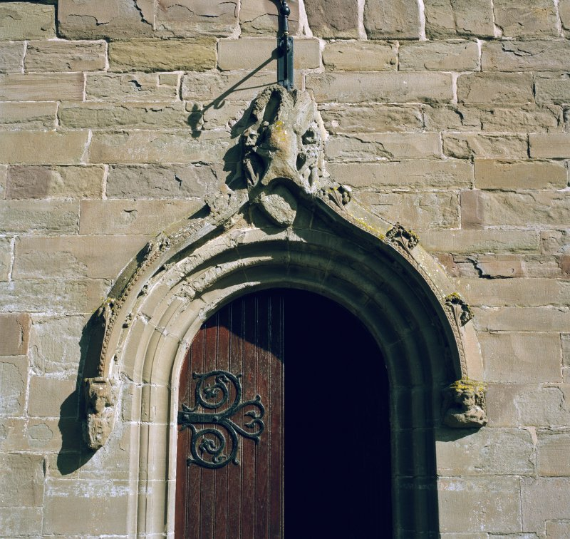 Detail of hoodmould above S entrance.