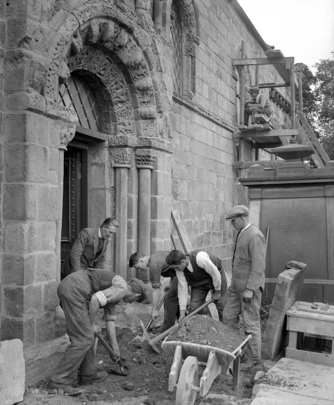View of workers outside Dalmeny Parish Church.