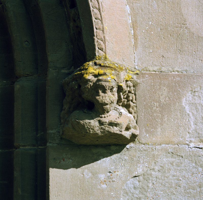 Detail of corbel on hoodmould above main entrance.