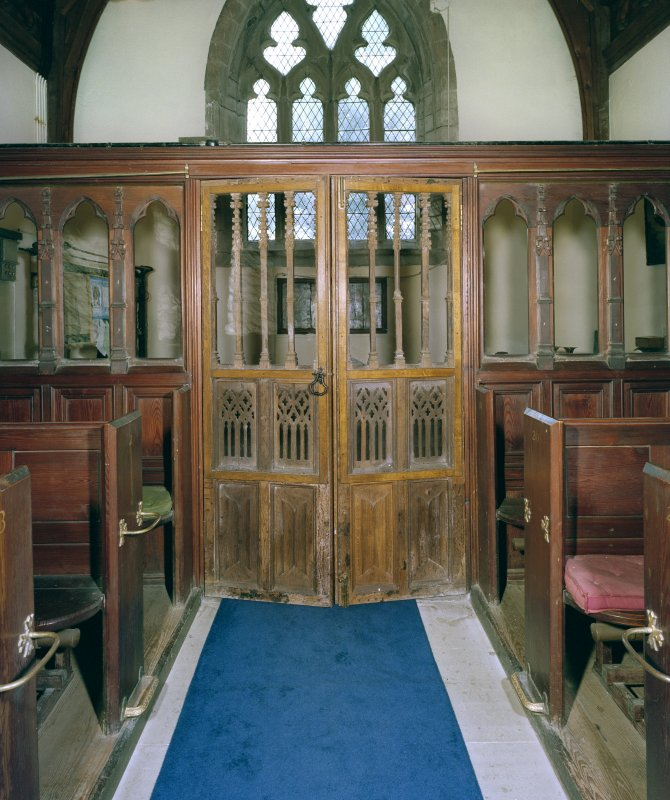 Interior. View of traceried doors in screen.