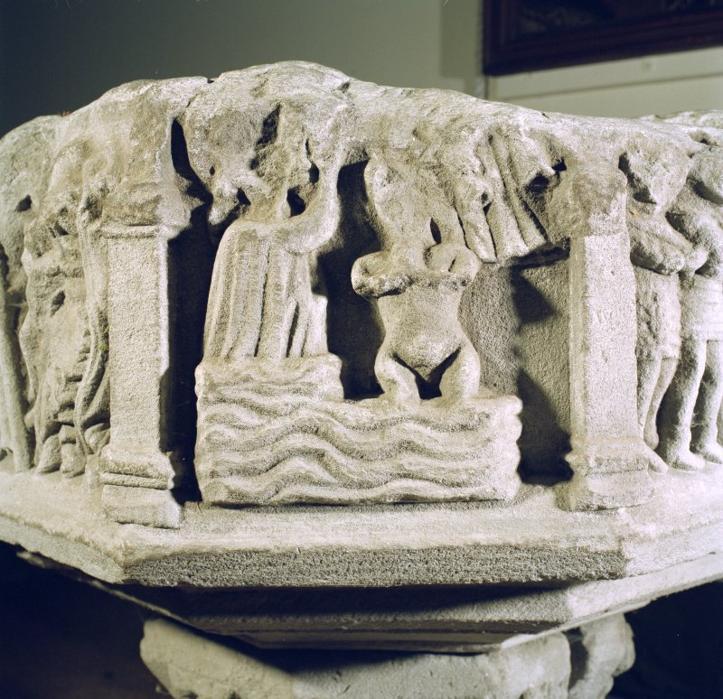 Interior. Detail of carved panel on font.