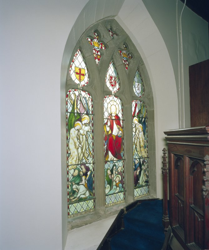 Interior. View of stained glass window in S wall behind pulpit.