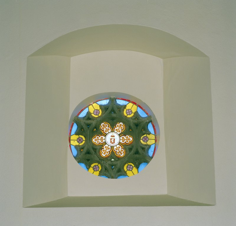 Interior. View of circular stained glass window in E wall.
