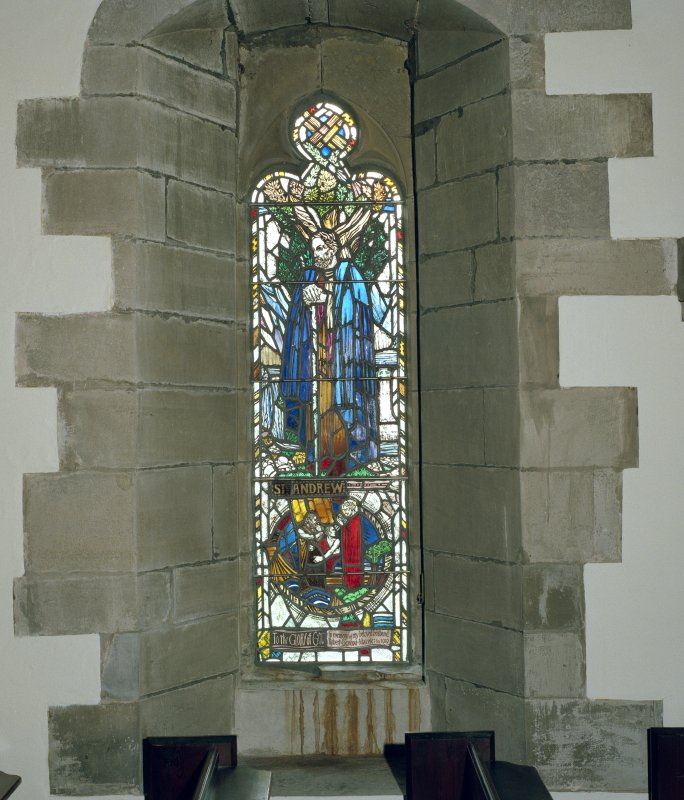 Interior. View of stained glass window in S wall.