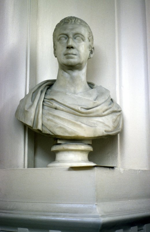 View of bust of an unknown man, in corner niche to right of door at end of box corridor.