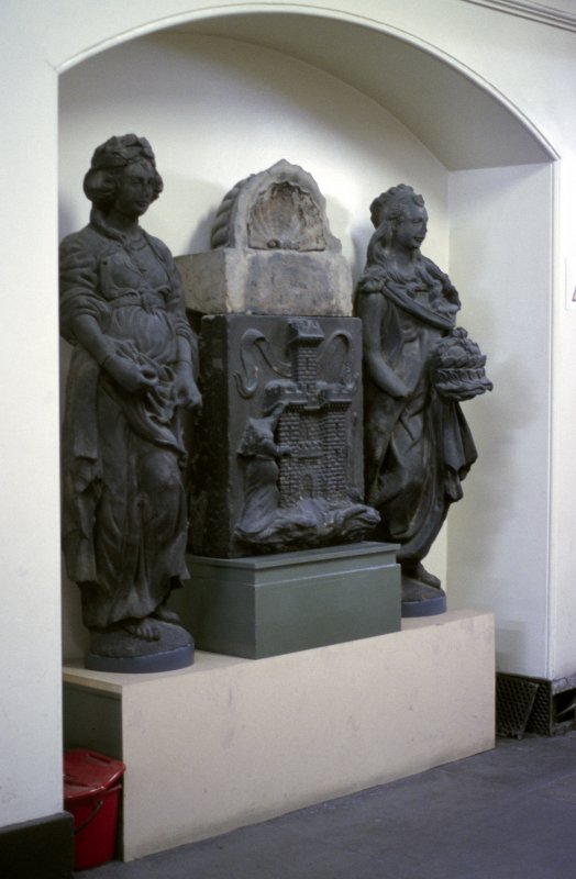 View of statues of Justice and Mercy, in niche in S corridor off Parliament Hall.