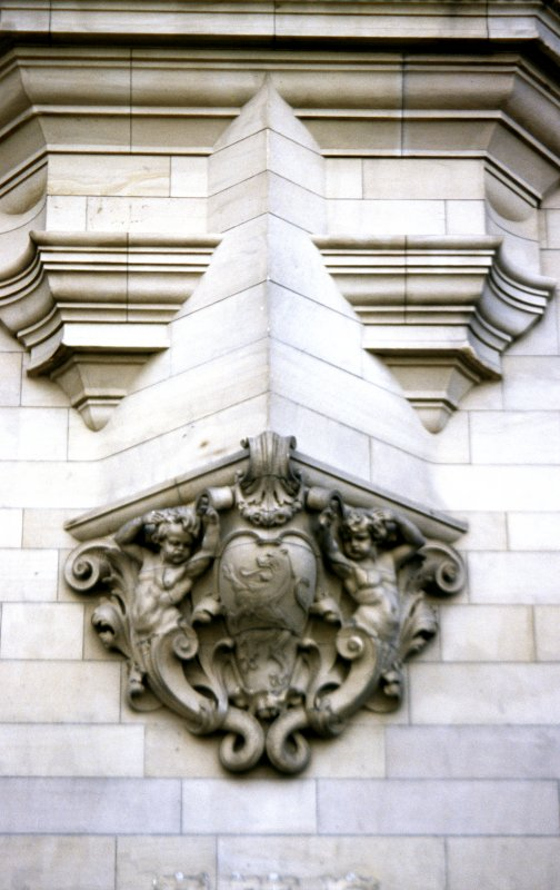 View of carved cartouche and putti, below corbel supporting first floor bay window of No.1 Market Street.