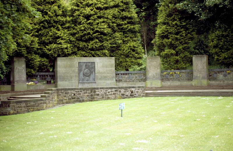 View of part of Royal Scots Memorial, showing main inscription plaque with regimental badge, and three carved monoliths.